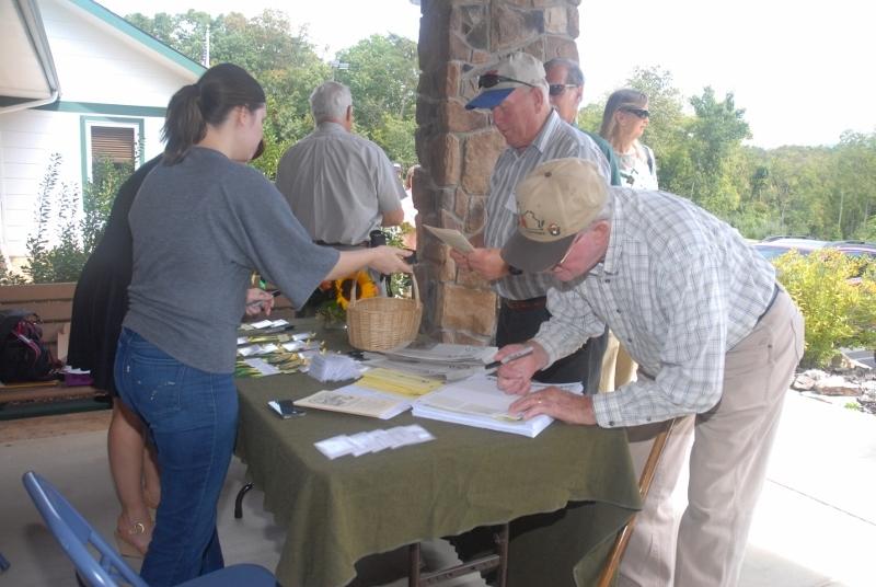 Volunteers welcoming guests